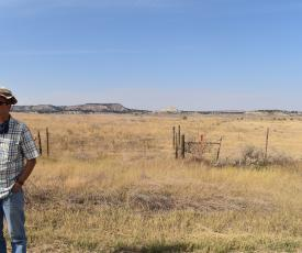 CREWS lead Rob Walker stands in front of a field in the Powder River Basin