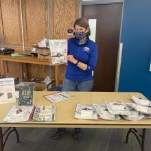 Suzi Taylor holds a citizen science kit at the giveaway